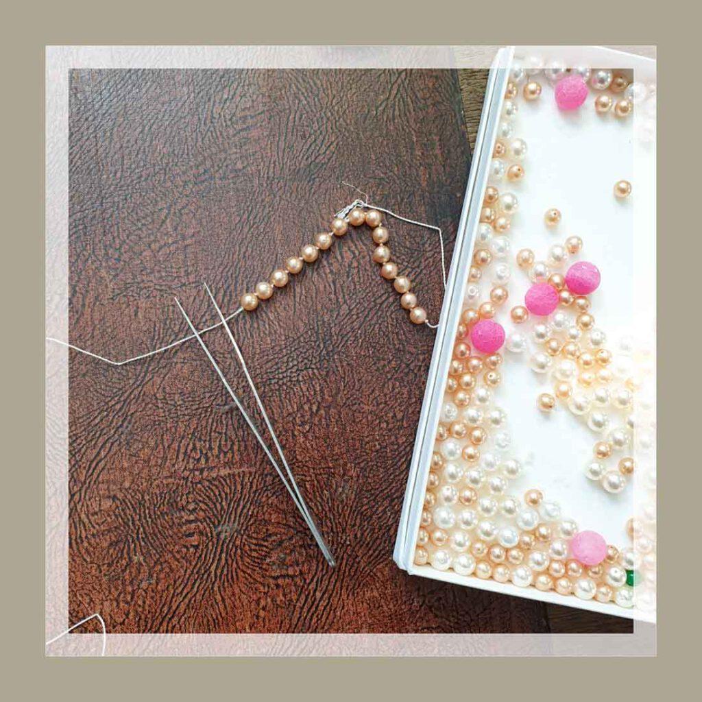 Perlenkette knüpfen